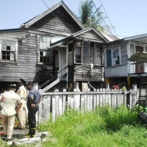 The partially damaged house under which the Police motorcycle exploded. [iNews' Photo]