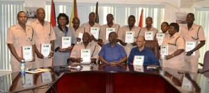 Minister of Home Affairs, Clement Rohee, Chairman of the Standing Orders Committee, Cecil Kilkenny,  Director of Prison, Welton Trotz and Senior Prison Officers with their Standing Order document.