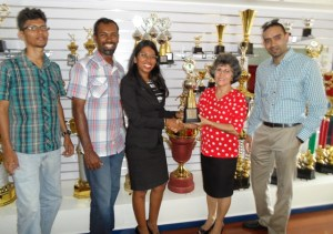 Vidushi Persaud (left) receives the sponsorship cheque from Luana Fernandes.