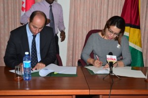 Georgia's Ambassador to Guyana, Otar Berdzenishvili and Minister of Foreign Affairs Carolyn Rodrigues-Birkett sign visa agreement.