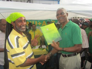 Presidential Candidate, David Granger presents the manifesto to one of the supporters. [iNews' Photo]
