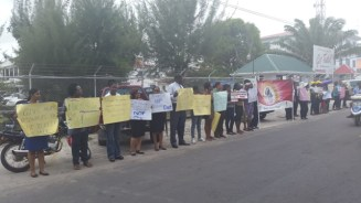Protesters in front the Ministry of Health. [iNews' Photo]