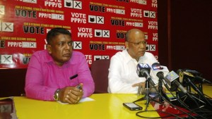 General Secretary of the PPP/C, Clement Rohee (right). [iNews' Photo]
