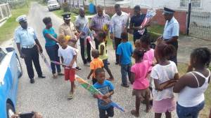 'A' Division Commander, Clifton Hicken and members of his team distribute kites to Children of North Sophia
