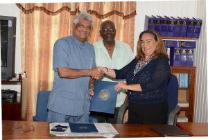 GECOM's Chairman Dr. Steve Surujbally and OAS Chief of Mission, Ms. Lisa Shoman