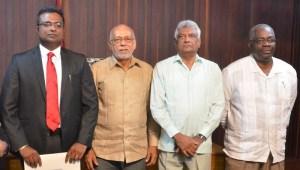 GECOM Commissioner Sase Gunraj standing besides former President Donald Ramotar; GECOM's Chairman, Dr Steve Surujbally and CEO of GECOM, Keith Lowenfield