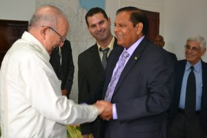 Prime Minister Moses Nagamootoo and Cuban Vice President of the Council of Ministers Ulises Rosales del Toro sharing a light moment