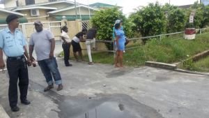 Some relatives of the dead teen outside the Diamond Hospital. [iNews' Photo]