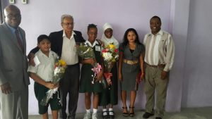 Minister of Education, Dr Rupert Roopnarine and others with the stop students. [iNews' Photo]