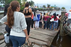 The alleged victims boarding  a boat at the Bartica Stelling for their journey to Georgetown