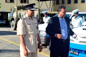 Commissioner of Police, Seelall Persaud (L) and Minister of Public Security, Khemraj Ramjattan.