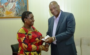 Minister Harmon makes the donation. [Jules Gibson Photo]