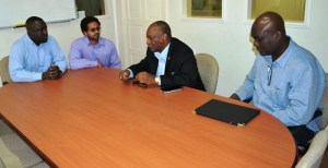 Minister of State, Joseph Harmon meets with Project Manager of the E-Governance Project, Alexei Ramotar and others.