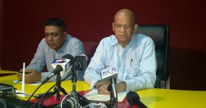 Former Minister of Home Affairs, Clement Rohee (R). [iNews' Photo]