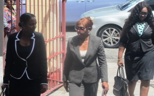 Former Minister Jennifer Westford (center) accompanied by Keisha Chase and Margaret Cummings [iNews Photo]
