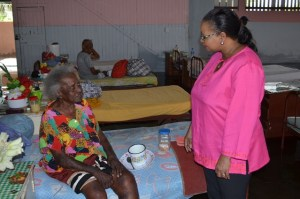 Minister Lawrence interacting with a resident of the Dharm-Shala