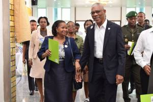 President David Granger and Minister of Social Protection Ms. Volda Lawrence arriving at the Arthur Chung Convention Centre. [Ministry of the Presidency Photo]