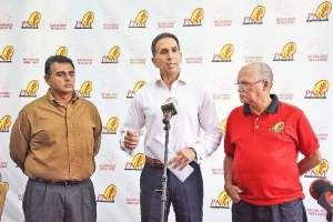 PNM public relations officer Faris Al-Rawi, centre, fields questions from the media during yesterday's news conference at Balisier House, Port of Spain. Looking on are Rohan Sinanan, left, campaign manager, and general secretary Ashton Ford.