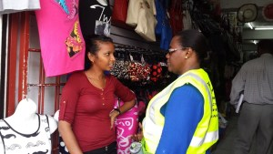 Minister Broomes interacting with an employee of a Regent Street Store. [iNews' Photo]