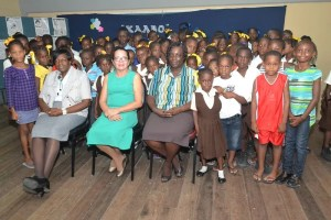 First Lady, Sandra Granger (centre) and Mrs. Genevieve Allen, with some of the children of the Remedial Project.