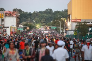 September 7,  2015 - Brooklyn, NY: Revelers celebrate J'Ouvert on Empire Blvd during dawn. The overnight celebration of Jouvet the night before the West Indies Parade was interrupted by intermittent gun violence and stabbings.