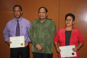 Prime Minister Moses Nagamootoo (center), Chairman of NCN Board of Directors, Vishaw Panday (left) and Chairperson of GNNL, Jean La Rose.