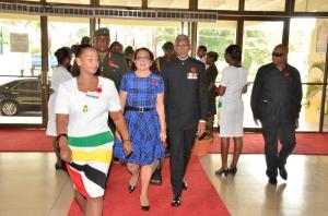 - President David Granger and First Lady, Mrs. Sandra Granger being ushered into the National Cultural Centre for the Guyana Defence Force's 50th anniversary church service