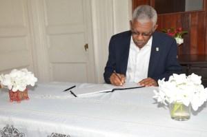 President David Granger signing the Book of Condolence
