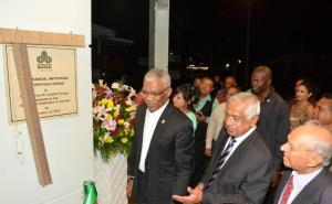 President David Granger, Chairman, Dr. Yesu Persaud, Board member, Mr. Hemraj Kissoon as they unveiled the plaque at the commissioning of the 7th Demerara Bank branch.