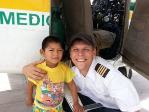 James Ash with one of the children assisted by his mission flights.