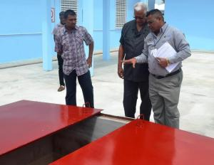 Minister Holder tours and inspects the newely commissioned chemical storage facility