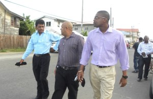 Minister Patterson with members of the Corriverton IMC taking a stroll on the road.