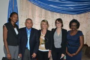 Minister of Public Health George Norton (second left), First Counsellor Deputy Chief of Mission of France Carolle Lucas (center) along with senior members of the Public Health Ministry