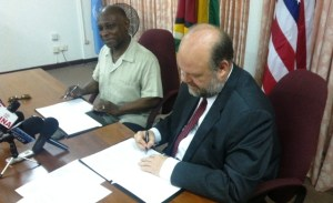 Minister of Foreign Affairs, Carl Greenidge and US Ambassador, Perry Holloway sign the agreement.