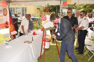 British High Commissioner, Greg Quinn making his donation to the Salvation Army's kettle