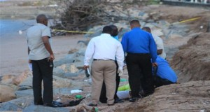 Investigators at the crime scene. [Guyana Chronicle Photo]
