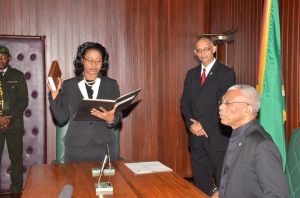 Justice Yonette Cummings-Edwards taking the Oath of Office of Chief Justice in the presence of President David Granger at the Ministry of the Presidency