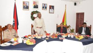 President David Granger addressing the Senior Officers and Division and Branch Commanders at the Guyana Police Force's Traditional Christmas Breakfast, this morning, while (at left) Commissioner of Police, Seelall Persaud, (at right) Prime Minister, Moses Nagamootoo and Minister of Public Security, Khemraj Ramjattan look on.