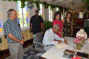 President David Granger signs the Dharm Shala's Visitor's Book