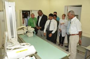 Administrator of the Leonora Diagnostic Centre, Mr. Dev Hira (centre) explains the functions of this piece of equipment in the X-ray Department of the Leonora Diagnostic Centre