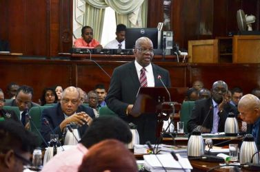 Finance Minister Winston Jordan presenting the 2016 budget in the National Assembly this afternoon (Carl Croker photo)