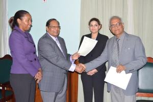 Prime Minister Moses Nagamootoo recieving the Guyana Bar Association's Report from its President Christopher Ram