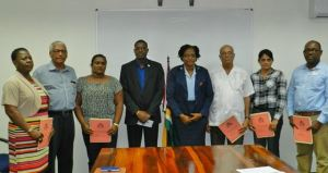 Minister of Public Infrastructure David Patterson (fourth from left) along with Minister within the Ministry of Public Infrastructure Annette Ferguson (fourth from right) and the newly elected board members of the Demerara Harbour bridge Inc