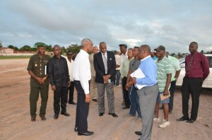 President Granger speaking with Project Manager Larry London as Minister of State, Joseph Harmon listens in
