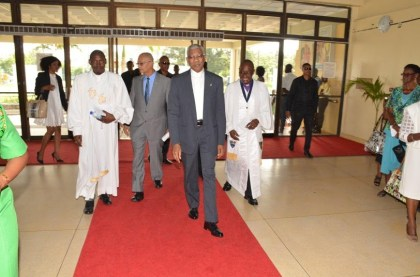 President David Granger being escorted into the National Cultural Centre by Bishop Otto Wade and Rev. Kofia Nials