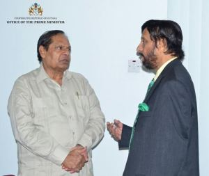 Prime Minister, Moses Nagamootoo and Chairman of Iwokrama, Dr Rajendra Pachauri in discussion