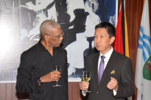 President David Granger shares a toast with Non-resident Ambassador of Japan to Guyana, Mr. Mitsuhiko Okada
