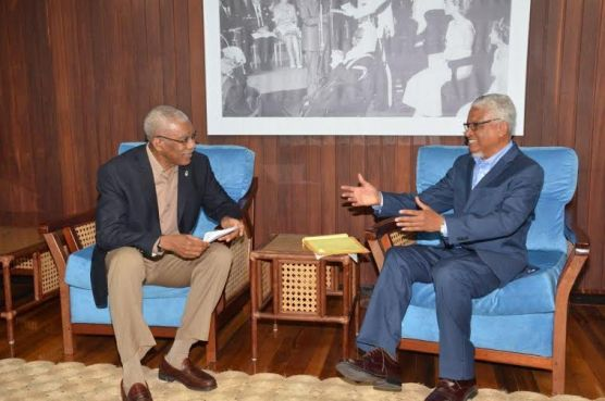 President David Granger and Professor Nigel Harris in a light moment before their discussions
