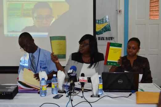 Minister in the Ministry of Public Health, Dr Karen Cummings shows stakeholders a copy each of the National Suicide and National Mental Health plans that the ministry has created