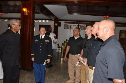 President Granger engages members of the Florida National Guard.  From right is Captain Christopher Hill, Staff Sergeant Anthony Lopes, Sergeant Matthew Hall, Sergeant First Class, Shannon Brasweoll and Sergeant First Class, Alden Morrow.